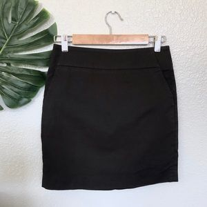 Ann Taylor black mini skirt with pockets size 2P